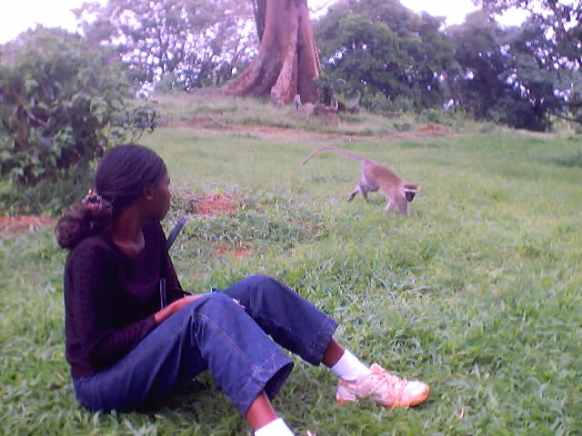 """Joanitha and monkey, national arboretum"", Entebbe, Uganda, 2003"