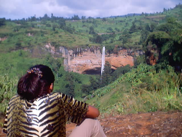 Joanitha viewing Sipi Falls, Mount Elgon, Uganda, 2003
