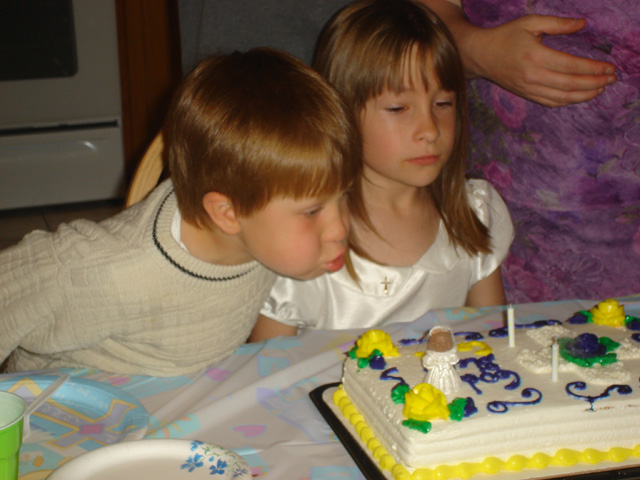 Dylan and Cassie with first communion cake, Fort Collins, Colorado, 2011