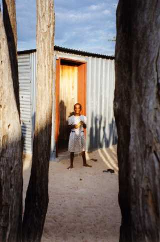 child outside a tin house, Oniipa, Namibia, 1995