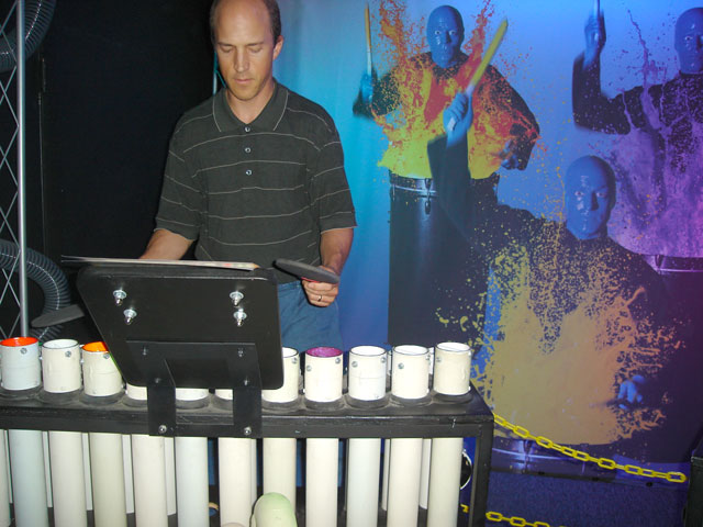 """Greg playing pipes with blue men, Children's Museum"", Denver, Colorado, 2007"