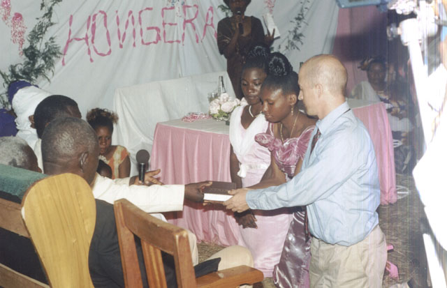 Greg and Joanitha receiving a bible at the sendoff party, Bukoba, Tanzania, 2003