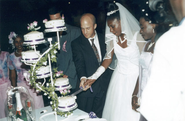 Greg and Joanitha cutting the wedding cake, Bukoba, Tanzania, 2003