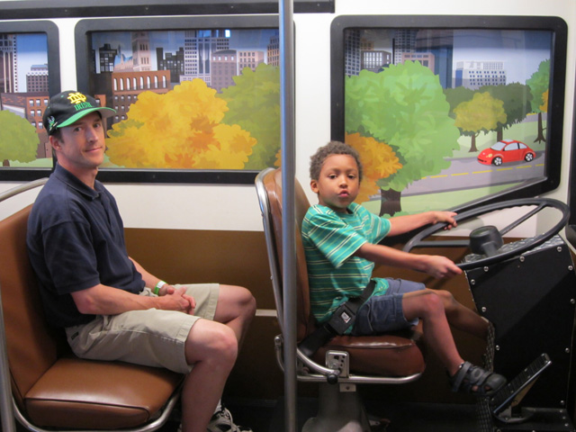 """Greg and Joachim on a bus, Milwaukee Children's Museum"", Milwaukee, Wisconsin, 2011"