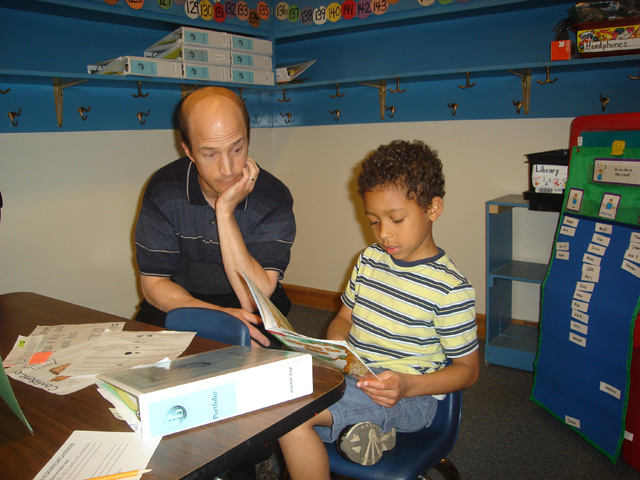 Joachim reading to Greg at Dunn Elementary, Fort Collins, Colorado, 2011
