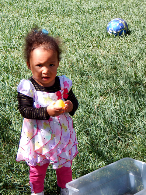 Irene with an Easter egg, Fort Collins, Colorado, 2015