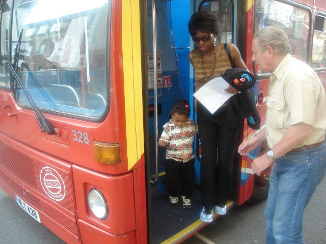 Joanitha and Joachim getting off a bus with Michael Hodd, Windsor, UK, 2008