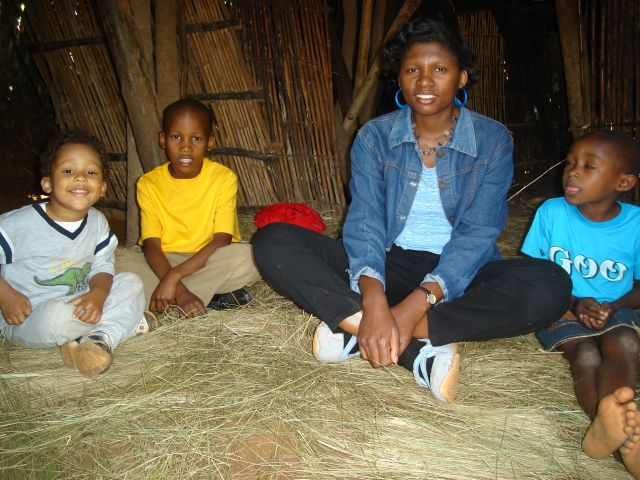 """Joachim, Deo, Joanitha and girl in a traditional hut"", ""Kanazi, Kagera"", Tanzania, 2008"