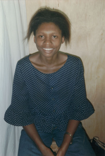 Joanitha at a photo studio, Kampala, Uganda, 2003
