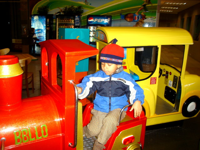 Joachim on kiddie rides at the mall, Fort Collins, Colorado, 2008