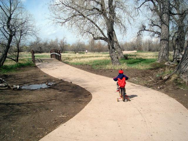 """Joachim on his bike by a bridge, Spring Canyon park"", Fort Collins, Colorado, 2009"