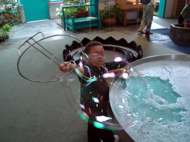 """Joachim making bubbles, children's museum"", Santa Fe, New Mexico, 2009"