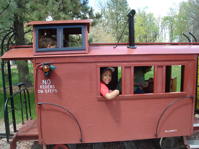 Joachim and Dylan in caboose of City Park train, Fort Collins, Colorado, 2010