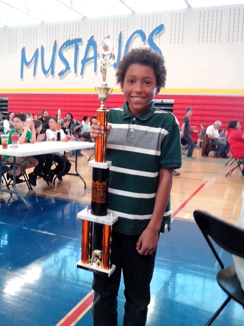 Joachim with his first place chess trophy, Fort Collins, Colorado, 2015