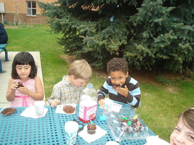 Joachim eating a cupcake at his birthday party, Fort Collins, Colorado, 2011