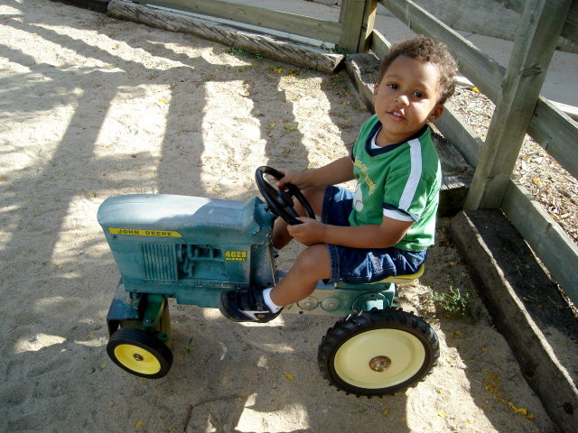 """Joachim on a toy tractor, Lee Martinez Park"", Fort Collins, Colorado, 2008"