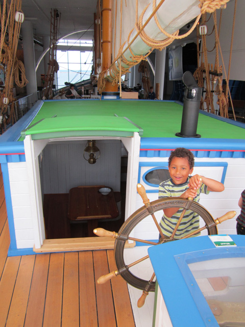 Joachim steering a ship in the Discovery museum, Milwaukee, Wisconsin, 2011