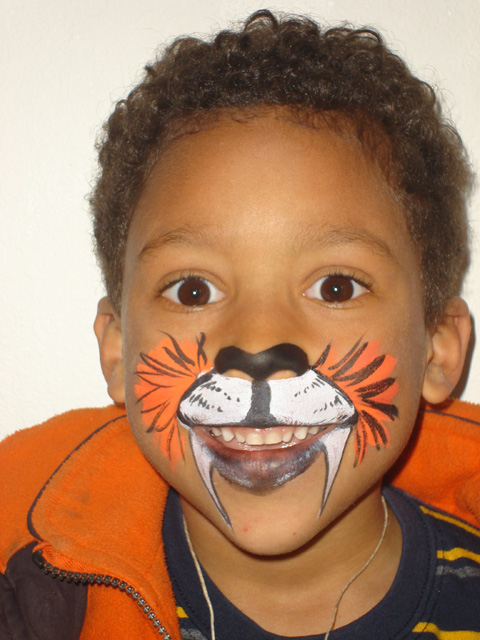 Joachim with tiger face paint, Fort Collins, Colorado, 2011