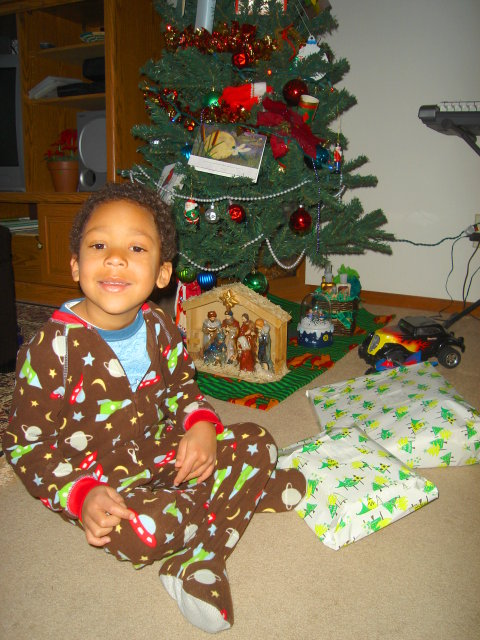Joachim with Christmas presents, Fort Collins, Colorado, 2009