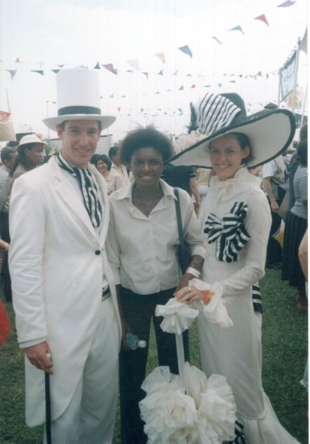 """Joanitha and two hatted characters, Speke Resort"", Munyonyo, Uganda, 2003"