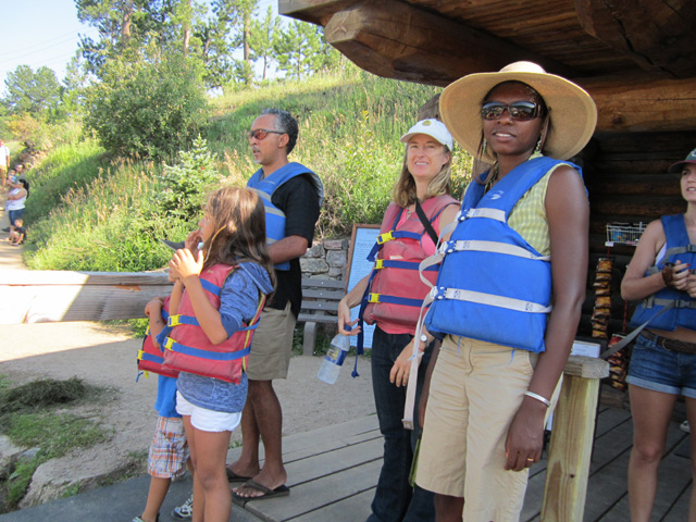 """Joanitha, Mary, Mohammed and kids with life jackets"", Evergreen, Colorado, 2011"