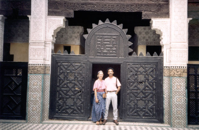 """Mary and Mohammed in a doorway, Médersa Bou Inania"", Meknès, Morocco, 1992"