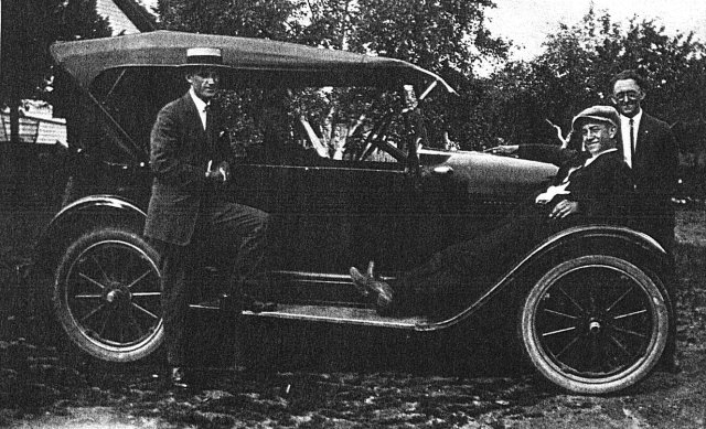 Michael Vogl with old car, Milwaukee, Wisconsin, 1930?