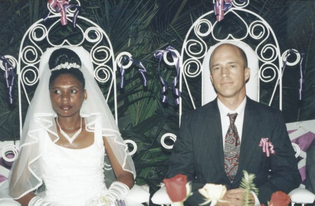 Greg and Joanitha seated at wedding reception, Bukoba, Tanzania, 2003