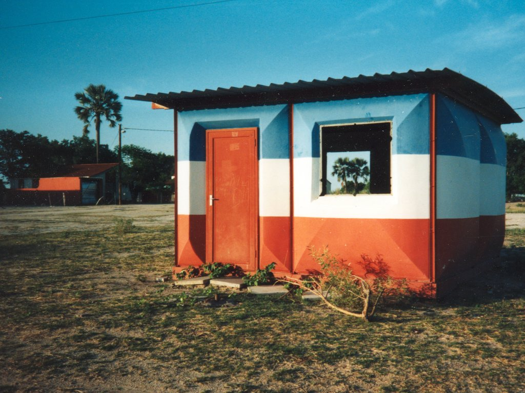 """Red, white and blue tin house"", Ohangwena, Namibia, 1997"