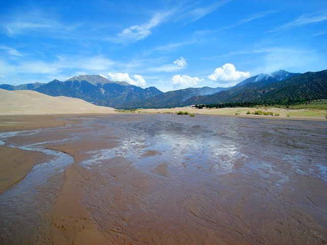 creek and forest fire, Great Sand Dunes National Park, Colorado, 2010