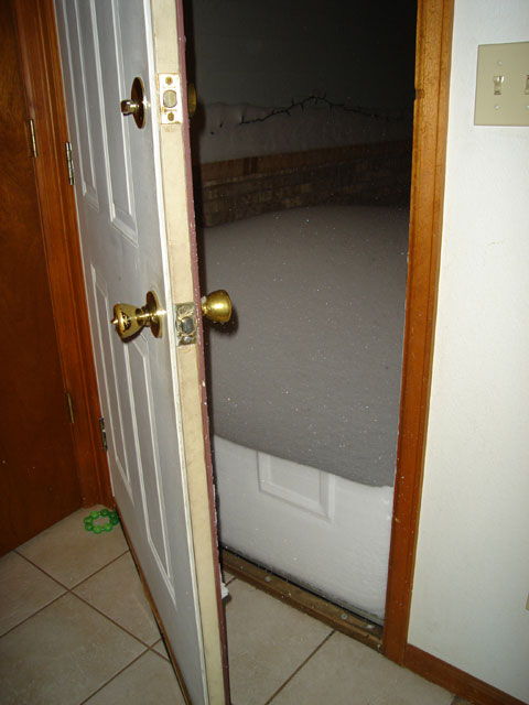 snow up against our front door, Fort Collins, Colorado, 2006