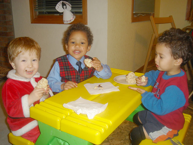 """Dylan, Joachim and Tariq eating snowmen"", Fort Collins, Colorado, 2007"