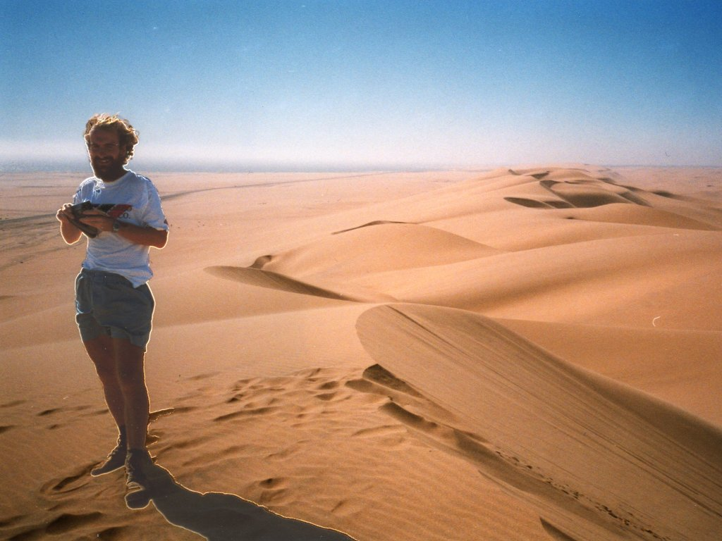 Andrew Cooper on a dune, Swakopmund, Namibia, 1996