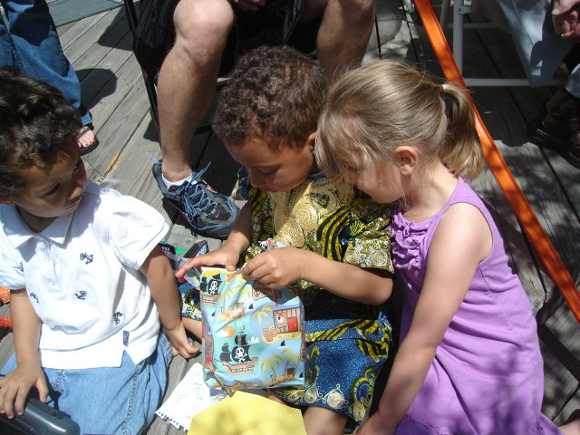 """Tariq, Joachim and Maddy with birthday presents"", Fort Collins, Colorado, 2009"