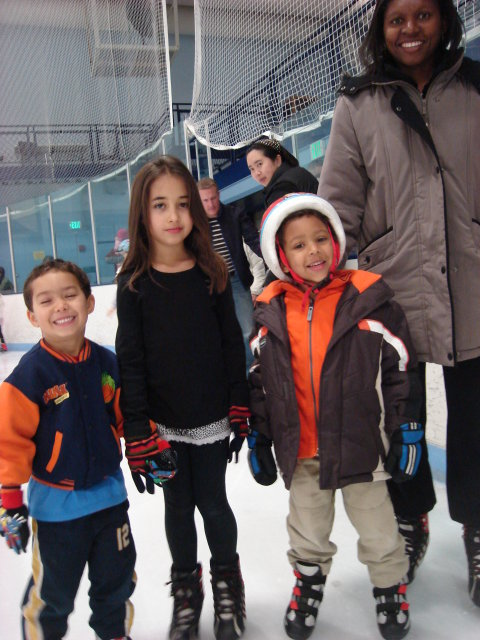 """Tariq, Latifah, Joachim and Joanitha ice skating"", Fort Collins, Colorado, 2010"