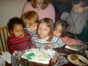 """Joachim, Dylan, Cassie, Latifah and Tariq blowing out Greg's birthday candles"", Fort Collins, Colorado, 2008"