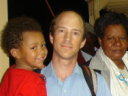 Greg and Joachim greeted by Joanitha's family on the ferry, Bukoba, Tanzania, 2008