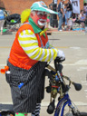 Clown on a bike in Memorial Day parade, DePere, Wisconsin, 2011