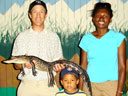 """Greg, Joanitha and Joachim with baby alligator"", Mosca, Colorado, 2010"
