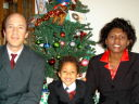 """Greg, Joanitha and Joachim on Christmas morning"", Fort Collins, Colorado, 2008"