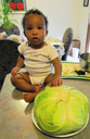 Irene with a cabbage at 11.5 months, Fort Collins, Colorado, 2014