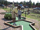 Joanitha and Joachim playing putt-putt, Rocky Mountain NP, Colorado, 2011