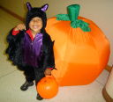 Joachim with bat costume by inflated pumpkin, Fort Collins, Colorado, 2008