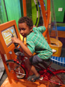 """Joachim in a bike, Discovery museum"", Milwaukee, Wisconsin, 2011"
