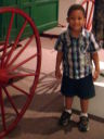 Joachim by a carriage in a museum, Albuquerque, New Mexico, 2009