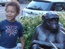 Joachim with chimp statue, Loveland, Colorado, 2007