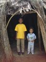 "Joachim and cousin Deo in a traditional hut, ""Kanazi, Kagera"", Tanzania, 2008"