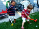 Joachim and Dylan playing golf, Fort Collins, Colorado, 2009