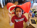 """Joachim with giant earphones, Little Shop of Physics"", Fort Collins, Colorado, 2011"