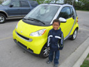 Joachim by an electric car, Milwaukee, Wisconsin, 2011